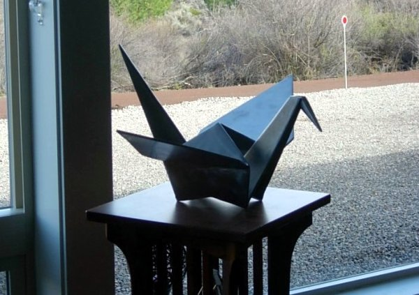 traditional crane on a origami sculpture customer's table