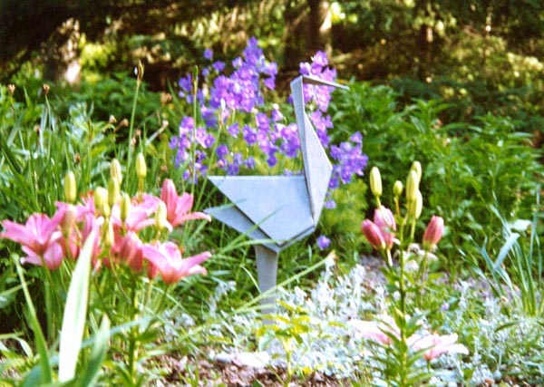 stainless standing crane in flowers