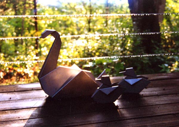 three steel swans on the deck